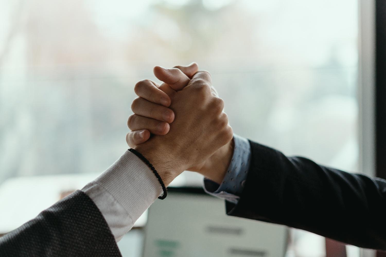 two-business-men-celebrating-a-deal-U8FC385-1